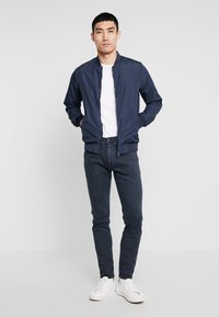 Replay - ANBASS HYPERFLEX - Slim fit jeans - blue - 1