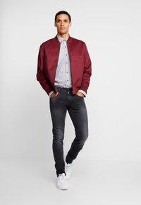 Replay - ANBASS HYPERFLEX - Slim fit jeans - medium grey - 1