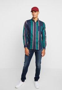 Replay - ANBASS HYPERFLEX - Jeans Slim Fit - dark blue - 1