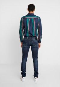 Replay - ANBASS HYPERFLEX - Jeans Slim Fit - dark blue - 2