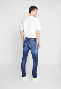 Replay - ANBASS HYPERFLEX - Slim fit jeans - dark blue - 2