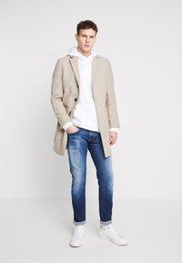 Replay - ANBASS HYPERFLEX - Slim fit jeans - dark blue - 1