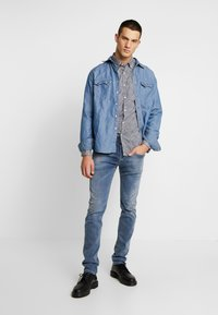 Replay - ANBASS HYPERFLEX  - Jeans slim fit - medium blue - 1