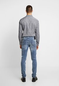 Replay - ANBASS HYPERFLEX  - Jeans slim fit - medium blue - 2