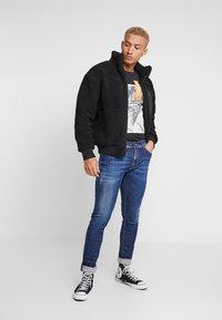 Replay - JONDRILL - Slim fit jeans - dark blue - 1