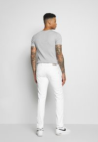 Replay - ANBASS - Slim fit jeans - white - 2