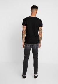 Replay - ANBASS HYPERFLEX - Jeans Slim Fit - dark grey - 2