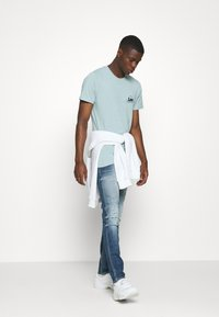 Replay - ANBASS AGED - Slim fit jeans - medium blue - 1