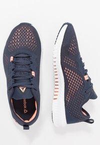 Reebok - FLEXAGON - Sports shoes - navy/sunglow/white - 1