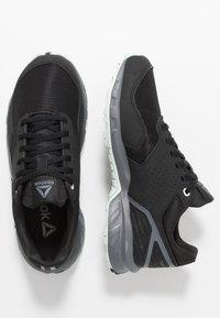 Reebok - RIDGERIDER TRAIL 4.0 - Trail running shoes - black/greyemerald ice - 1