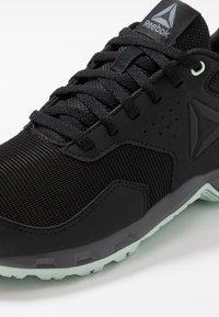 Reebok - RIDGERIDER TRAIL 4.0 - Trail running shoes - black/greyemerald ice - 5