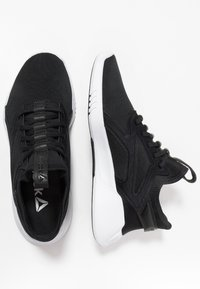 Reebok - FREESTYLE MOTION - Neutral running shoes - black/white - 1
