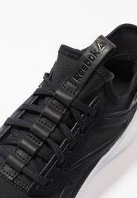 Reebok - FREESTYLE MOTION - Neutral running shoes - black/white - 5