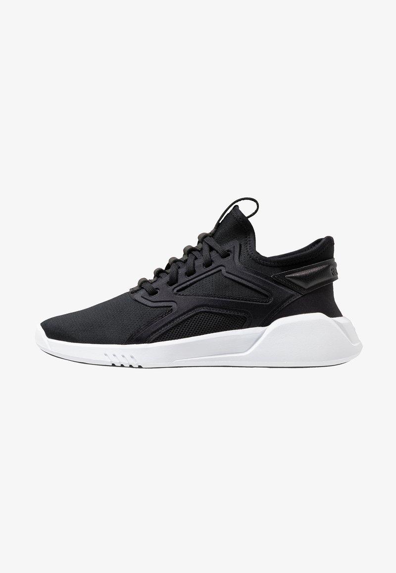 Reebok - FREESTYLE MOTION - Neutral running shoes - black/white