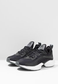 Reebok - SOLE FURY 00 - Sports shoes - black/white - 2