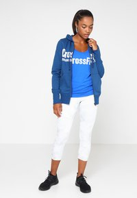 Reebok - GRAPHIC TANK - T-shirt sportiva - vital blue - 1
