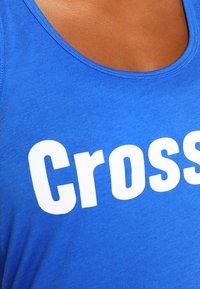 Reebok - GRAPHIC TANK - T-shirt sportiva - vital blue - 6