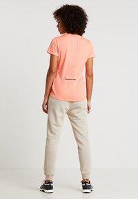 Reebok - TEE - T-Shirt print - orange - 2