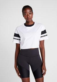Reebok - SOLID TEE - T-shirt print - white - 0