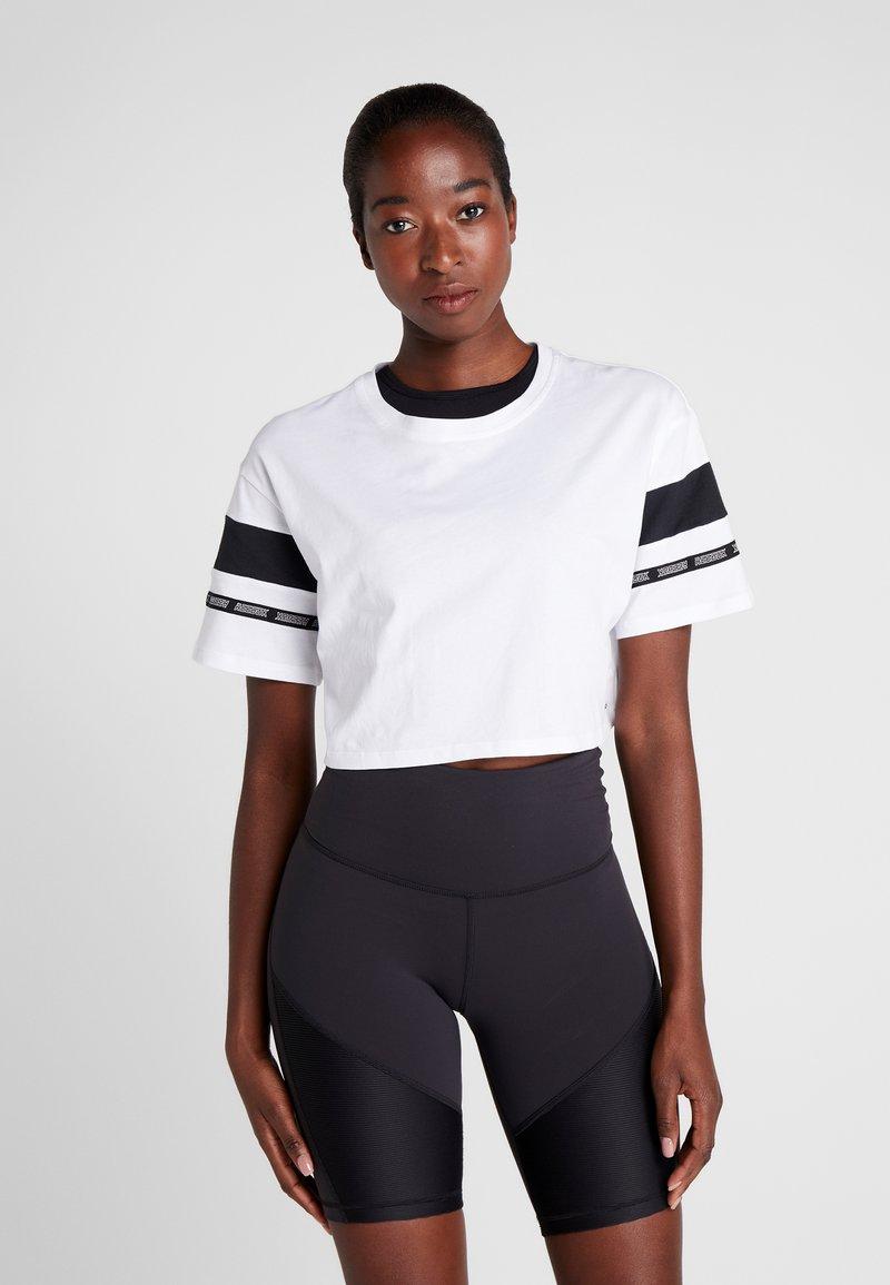 Reebok - SOLID TEE - T-shirt print - white
