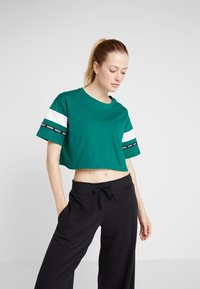 Reebok - SOLID TEE - T-shirt med print - green - 0
