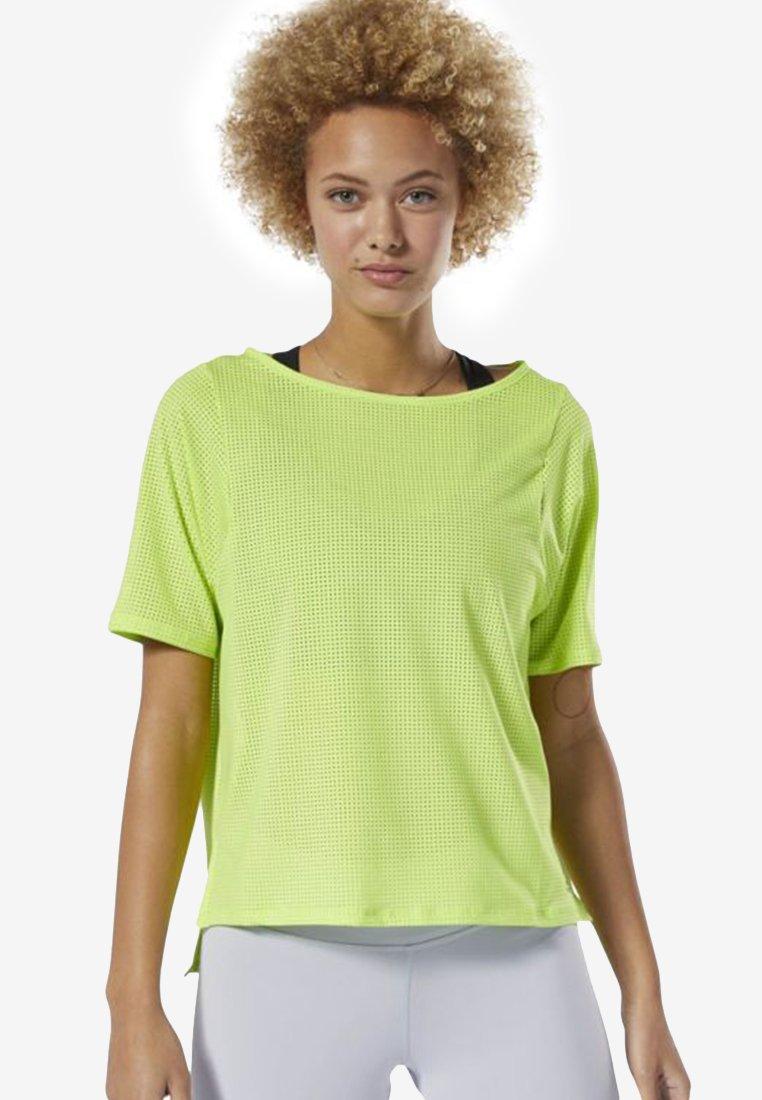 Reebok - PERFORATED TEE - Basic T-shirt - green