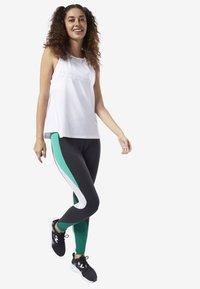 Reebok - PERFORATED PERFORMANCE TANK TOP - T-shirt de sport - white - 1