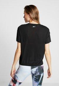 Reebok - WOR SUP TEE - T-shirt imprimé - black - 2