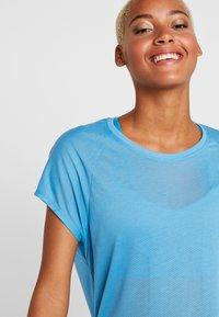 Reebok - TEE - T-shirts med print - cyan - 3