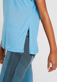 Reebok - TEE - T-shirts med print - cyan - 4