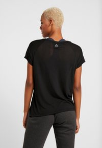 Reebok - TEE - T-shirts med print - black - 2