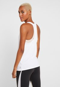 Reebok - GRAPHIC TANK - Sports shirt - white