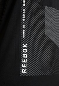 Reebok - GRAPHIC TANK - Tekninen urheilupaita - black - 6