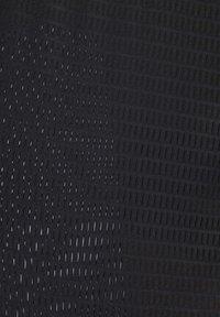 Reebok - PERFORATED TEE - T-shirts med print - black - 7