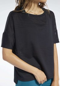 Reebok - PERFORATED TEE - T-shirts med print - black - 4