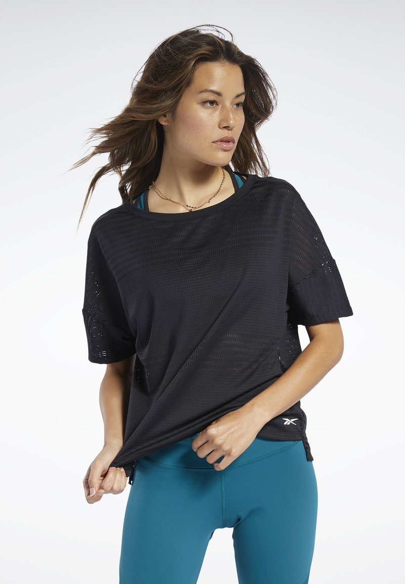 Reebok - PERFORATED TEE - T-shirts med print - black