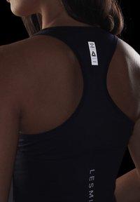 Reebok - LES MILLS® BODYCOMBAT® TANK TOP - Treningsskjorter - purple - 3