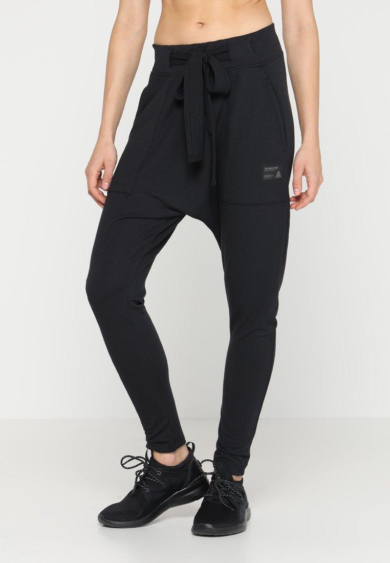 Reebok - STRIKER PANT - Tracksuit bottoms - black