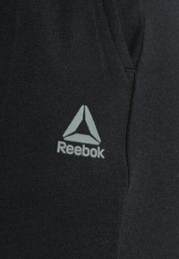 Reebok - Jogginghose - black