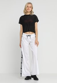 Reebok - WIDE LEG  - Tracksuit bottoms - white