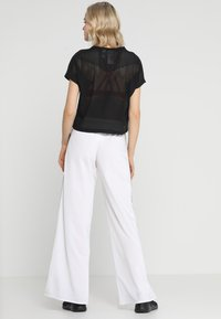 Reebok - WIDE LEG  - Tracksuit bottoms - white - 2