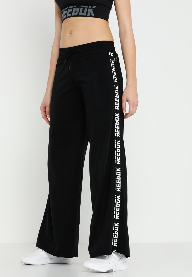 Reebok - WIDE LEG  - Jogginghose - black