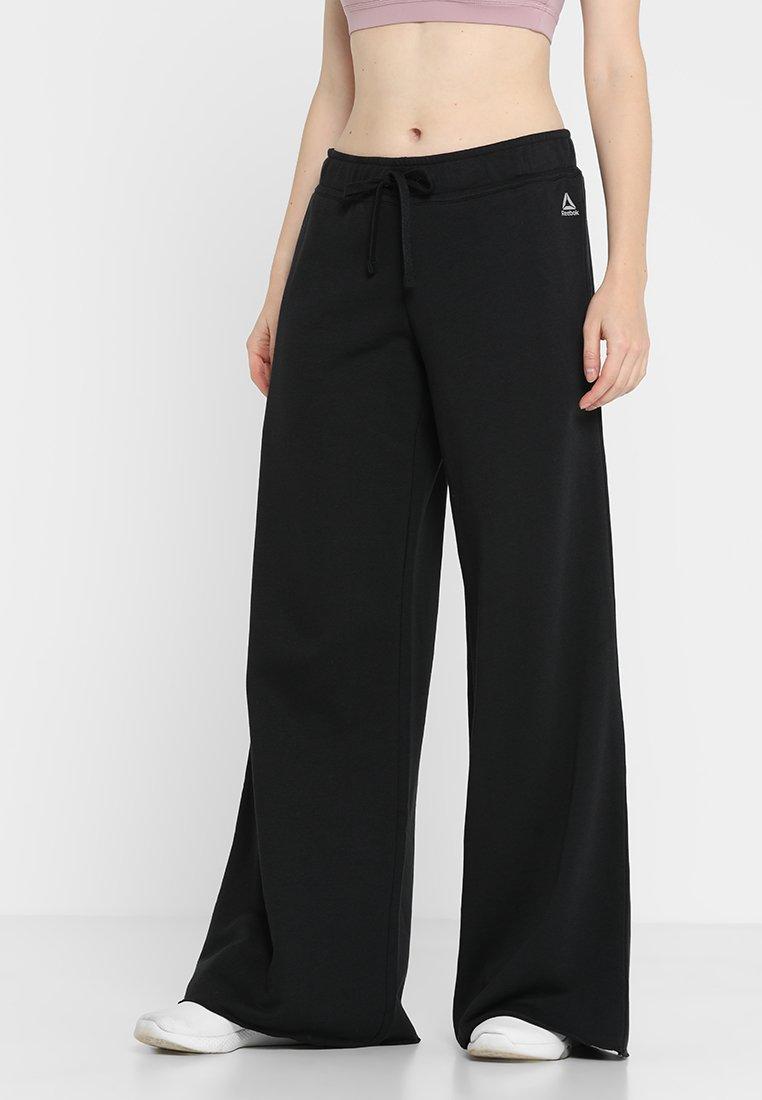 Reebok - WIDE LEG PANT - Teplákové kalhoty - black