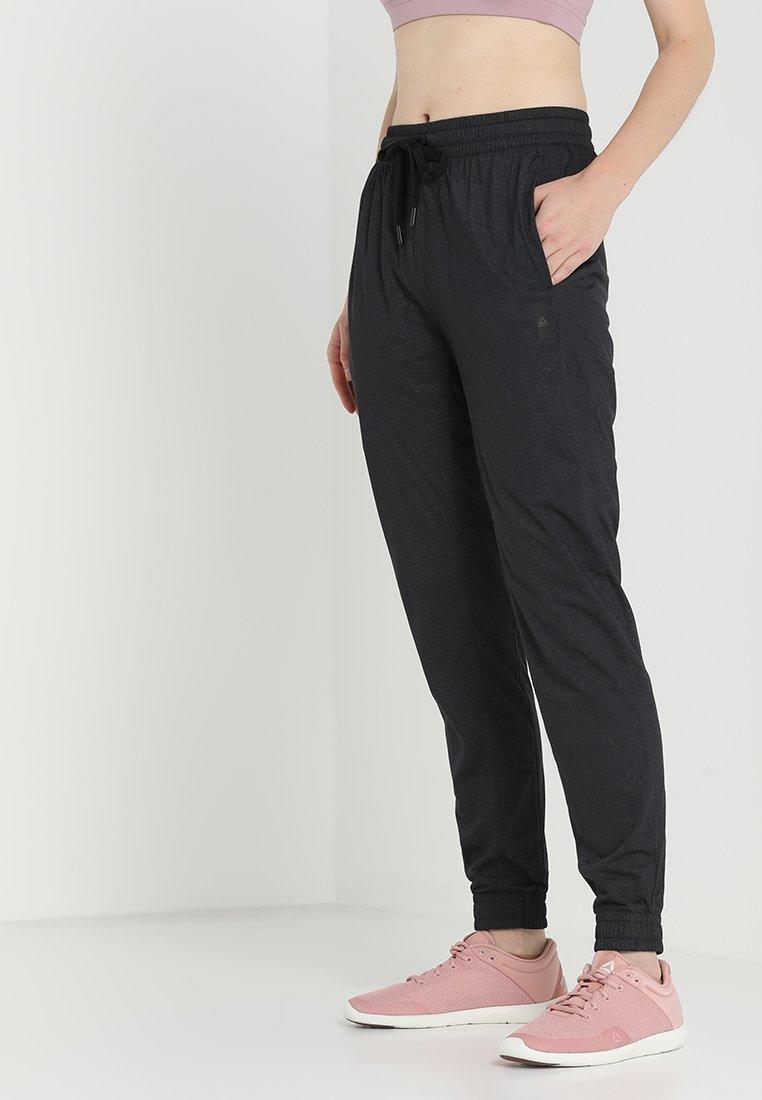 Reebok - PANT - Pantalones deportivos - black