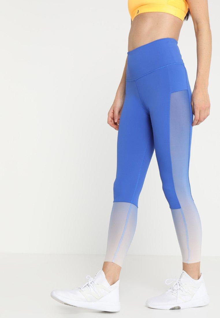 Reebok - OMBRE - Leggings - blue