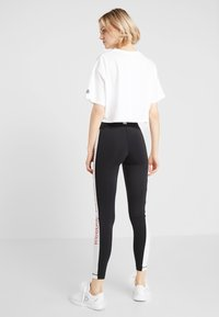 Reebok - TRAINING ESSENTIALS LINEAR LOGO LEGGING - Punčochy - black - 2