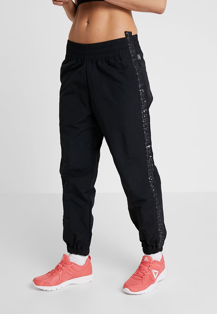 Reebok - PANT - Tracksuit bottoms - black