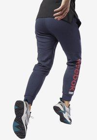 Reebok - TRAINING ESSENTIALS LINEAR LOGO PANTS - Tracksuit bottoms - heritage navy - 2
