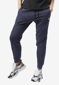 Reebok - TRAINING ESSENTIALS LINEAR LOGO PANTS - Tracksuit bottoms - heritage navy - 0