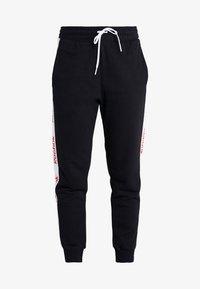 Reebok - LINEAR LOGO PANT - Teplákové kalhoty - black - 3